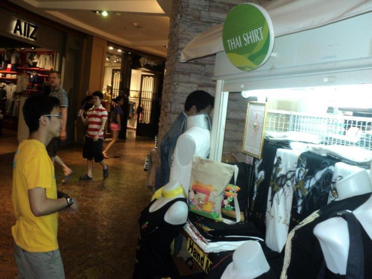 The kiosk selling the t-shirt.