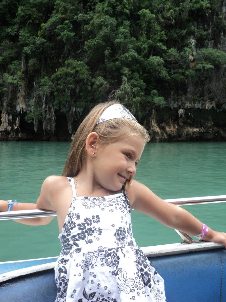 On the way to the James Bond Island. This kid is so cute and photogenic! ;D