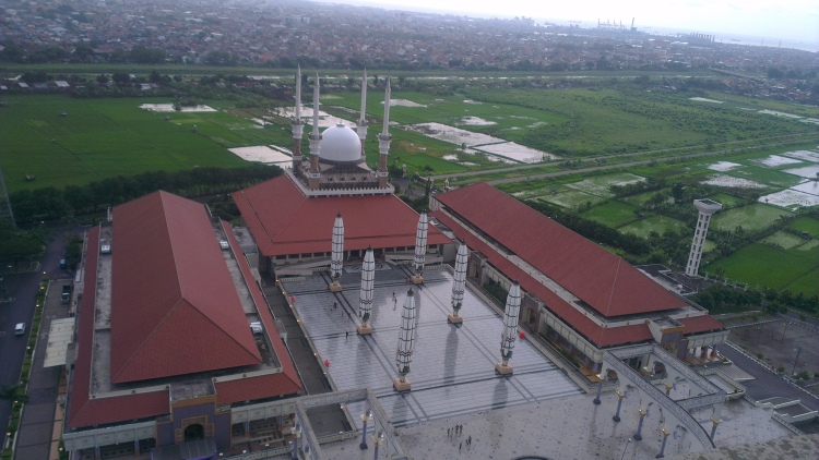 The mosque, situated beside a paddy-field...