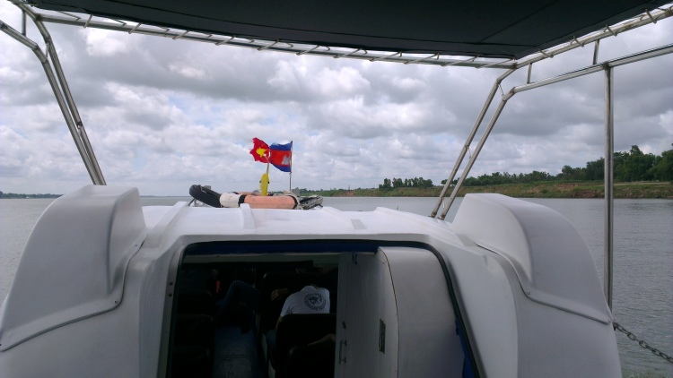 Cambodian flag in front and Vietnam flag at the back...
