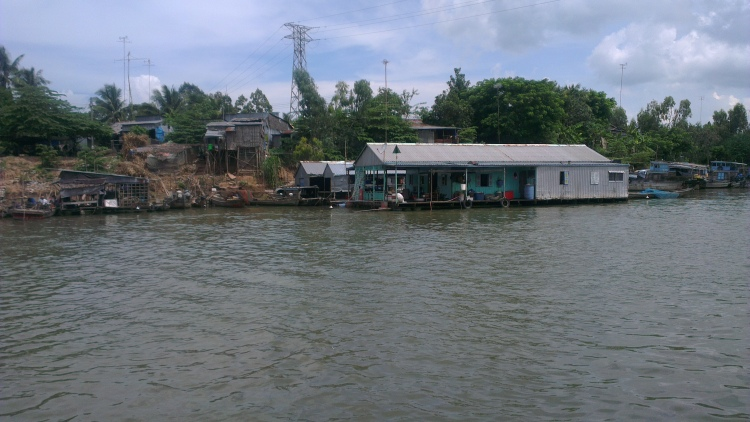 Floating house by the side of Mekong River.