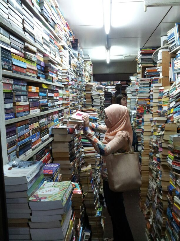 My friend with the sea of books.