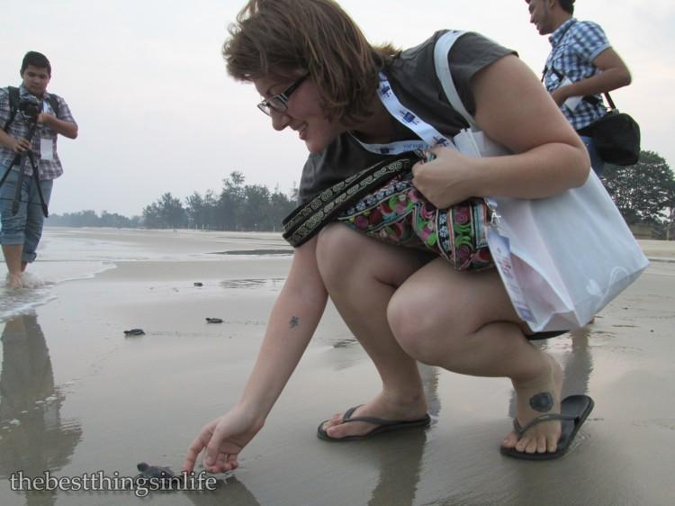 Fellow blogger, Jessie [http://travelthisblogmofo.wordpress.com] releasing a baby turtle...